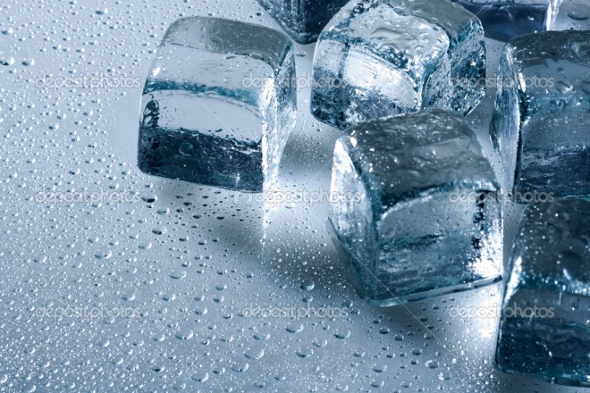 Ice cube and water drops on the wet background