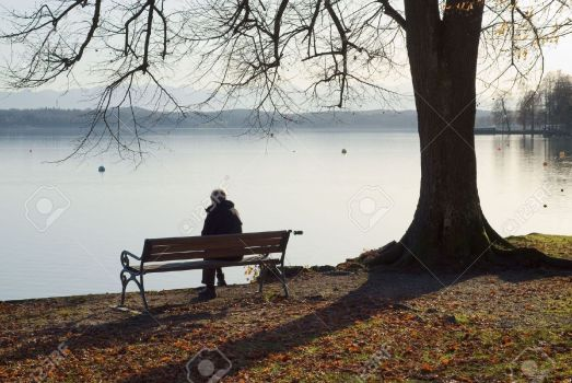 5950166-Lonely-Man-Sitting-Next-to-a-Lake-Stock-Photo-sad