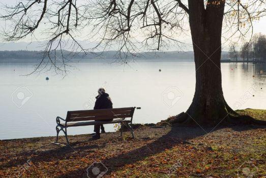 5950166-Lonely-Man-Sitting-Next-to-a-Lake-Stock-Photo-sad
